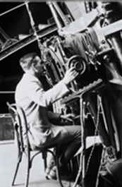 Edwin Hubble observing on the 100-inch telescope. Image courtesy of the Observatories of the Carnegie Institution for Science.